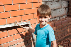 Little helper, boy at work Royalty Free Stock Photography