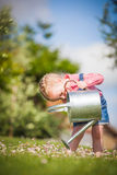 Little helper on the green grass in summer day Royalty Free Stock Photos