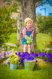 Little helper on the green grass in summer day Royalty Free Stock Photo