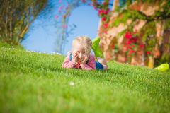 Little helper on the green grass in summer day Stock Photos