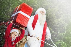 Little helper of Santa Claus brings gifts Royalty Free Stock Images