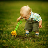 Little helper with a shovel Stock Photos