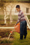 Little helper watering flowers in the garden Royalty Free Stock Photography