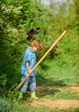 Little helper working in garden. Cute child in nature having fun with shovel. I want to find treasures. Happy childhood. Adventure hunting for treasures royalty free stock photos