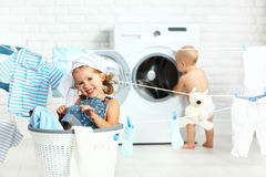 Little helpers funny kids happy sister and brother in laundry to Stock Image