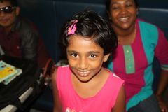 Little hindu girl with nice smile traveling on the train royalty free stock photo