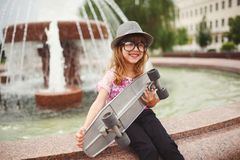 Little hipster girl with big glasses Stock Images