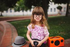 Little hipster girl with big glasses Royalty Free Stock Image