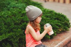 Little hipster girl with coctail Royalty Free Stock Photo