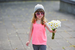 Little hipster girl with flowers. Photo of beautiful little hipster girl with flowers Royalty Free Stock Images