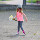 Little hipster girl with flowers. Photo of beautiful little hipster girl with flowers Royalty Free Stock Photos