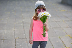 Little hipster girl with flowers. Photo of beautiful little hipster girl with flowers Stock Images