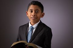 Free Little Hispanic Boy Holding The Holy Scriptures, The Word Of God, The Bible Royalty Free Stock Photo - 138509285