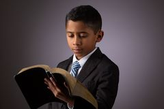 Free Little Hispanic Boy Reading The Holy Scriptures, The Bible, The Word Of God Stock Images - 138509284