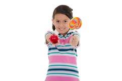 Little hispanic girl with big lollipop Stock Photos