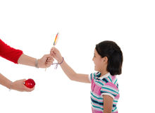 Little hispanic girl with big lollipop Royalty Free Stock Photography