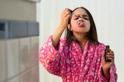 Little Hispanic Girl Takes her Medicine Stock Photography