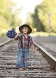 Little Hobo. Adorable little girl dressed as a hobo and walking the railroad tracks stock photo