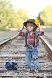 Little Hobo. Adorable little girl dressed as a hobo and walking on the railroad tracks royalty free stock photos