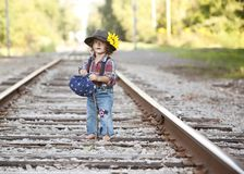 Little Hobo. Adorable toddler dressed as a hobo and standing on the railroad tracks. Room for your text stock image