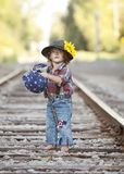 Little Hobo. Adorable toddler dressed as a hobo and standing on the railroad tracks. Room for your text stock photo