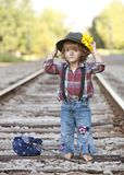Little Hobo. Adorable toddler dressed as a hobo and standing on the railroad tracks. Room for your text stock photography