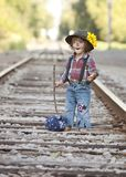 Little Hobo. Adorable toddler dressed as a hobo and walking the railroad tracks stock images