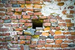 Little hole in an old brick wall Stock Photography