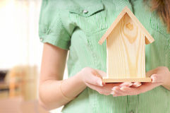 Little home in the hands. Of young woman Stock Photography