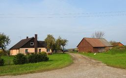 Little home near road, Lithuania Royalty Free Stock Image