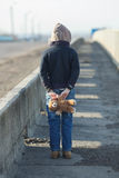Little homeless boy holding a teddy bear Royalty Free Stock Image
