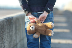 Little homeless boy holding a teddy bear Stock Photography