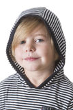 Little hoody. Young boy wearing striped shirt and hood smiling at the camera Stock Photo