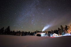 Little House on the background of the starry sky in winter Stock Photos
