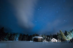 Little House on the background of the starry winter sky Royalty Free Stock Images