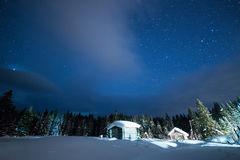 Little House on the background of the starry winter sky Stock Photography