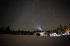 Little House on the background of the starry winter sky Stock Photos
