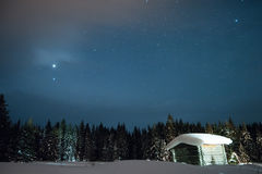 Little House on the background of the starry winter sky Royalty Free Stock Photo