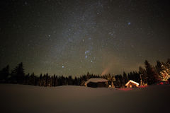 Little House on the background of the starry winter sky Royalty Free Stock Photography