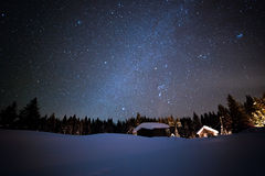 Little House on the background of the starry winter sky Stock Image