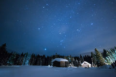 Little House on the background of the starry winter sky Royalty Free Stock Photos
