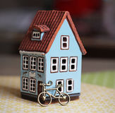 Little house and bicycle royalty free stock photo