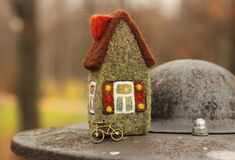 Little house and bicycle. Little toy house and bicycle Royalty Free Stock Image