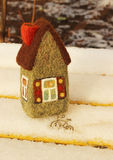 Little house and bicycle. Little toy house and bicycle on snow Stock Photo