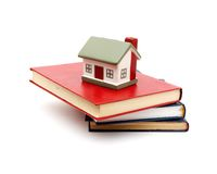 Little house and books Stock Photos