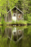 Little House By The Lake Royalty Free Stock Photography