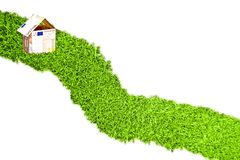 Little house from euro money on grass road Royalty Free Stock Image