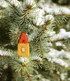 Little house on fir tree branch. Little toy house and christmas tree with snow Stock Photography