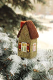 Little house on fir tree. Little house on  fir tree brunches with snow Royalty Free Stock Photography