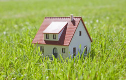 Little house on grass Royalty Free Stock Photos